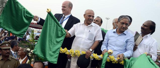 Train carrying automobiles flagged off