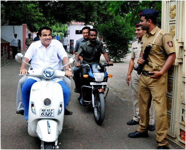 Nitin Gadkari, Union transport and highways minister, rides scooter without helmet